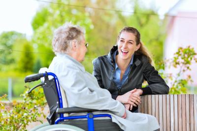 senior woman talking to caregiver